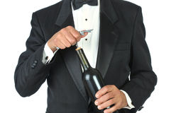 Waiter opening wine bottle Stock Photos