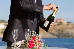 Waiter opens wedding champagne Royalty Free Stock Photo