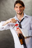 Waiter opens wine bottle. Winery serving tasting alcohol liquor concept. Waiter opens wine bottle. Young male sommelier pulls out cork stock image