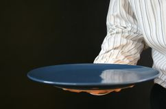 Waiter plate. Waiter delivers an empty plate Stock Photo