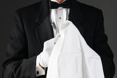 Waiter Polishing Stemware Stock Image