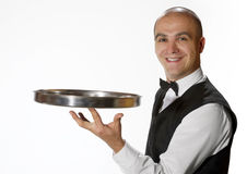 Waiter portrait. Young waiter smiling portrait isolated on white stock images