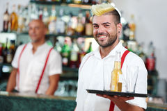 Waiter portrait standing near bartender desk in restaurant bar Royalty Free Stock Photography