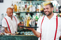 Waiter portrait standing near bartender desk in restaurant bar Royalty Free Stock Photos