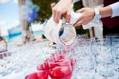 Waiter pour cherry juice Royalty Free Stock Image