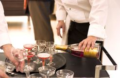 Waiter pouring champagne stock images