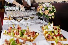 Waiter pouring champagne in the party event. Reception at the wedding party or Banquet for the anniversary. Waiter pouring champagne in the party event stock images