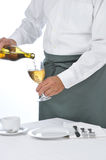 Waiter Pouring a Glass of Wine Royalty Free Stock Images