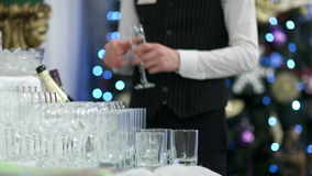 Waiter pouring glasses of champagne Stock Image
