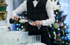 Waiter pouring glasses of champagne Royalty Free Stock Image