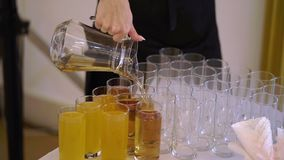 Waiter pouring juice. To glasses stock footage