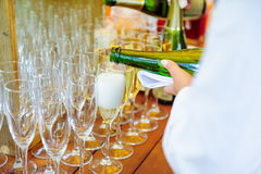 Waiter pouring personal serving Champagne in glasses. Catering service at events, corporate meeting, party, weddings. Selective fo Royalty Free Stock Photo