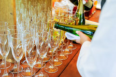 Waiter pouring personal serving Champagne in glasses. Catering service at events, corporate meeting, party, weddings. Selective fo Royalty Free Stock Photos