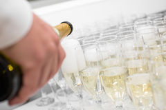 Waiter pours champagne Stock Images