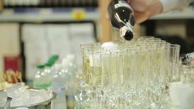 The waiter pours champagne into glasses stock video footage