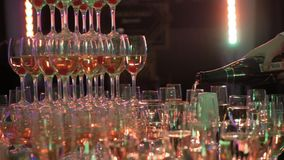 Waiter Pours Champagne Into a Tower of Glasses, Party And Celebration, Close Up Shot stock footage