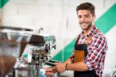 Waiter pours coffee Royalty Free Stock Photo