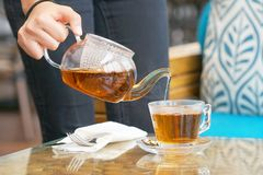 The waitress gives tea to the client royalty free stock photography