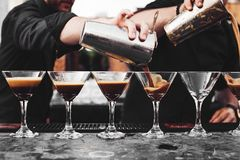 The waiter pours wine into a glass. Drink Royalty Free Stock Photo