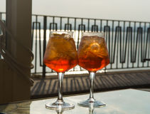Waiter prepared the Aperol Sprits summer cocktail with Aperol, p Stock Image