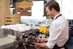 Waiter preparing coffee royalty free stock photos