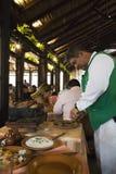 Waiter preparing food in a restaurant in Bolivia Stock Photos