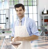 Waiter preparing red wine in restaurant Royalty Free Stock Photography