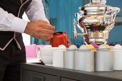 Waiter preparing tea Stock Photos