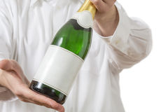 Waiter presenting a botle of Champagne Royalty Free Stock Images