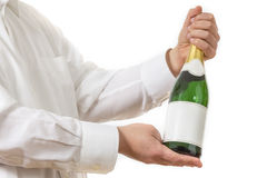 Waiter presenting a botle of Champagne Royalty Free Stock Photography