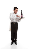 Waiter presenting a bottle of alcohol Stock Photos