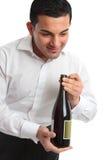 Waiter presenting bottle of wine stock photography