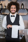 Waiter ready for serving customers. Portrait of smiling waiter ready for serving customers in bar Royalty Free Stock Images