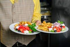 Waiter at restaurant kitchen Royalty Free Stock Photo