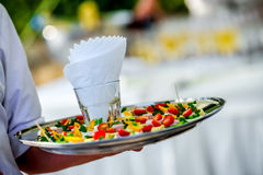 Waiter's serving appetizers Royalty Free Stock Photo