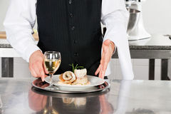 Waiter With Salmon Roll And White Wine Stock Photo