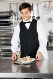 Waiter With Salmon Roll And White Wine Royalty Free Stock Photography