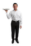 Waiter or Servant. Smiling waiter or servant holding a silver tray. White background royalty free stock images