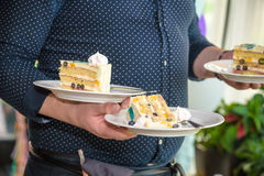 Waiter serves a birthday cake at a party Stock Image