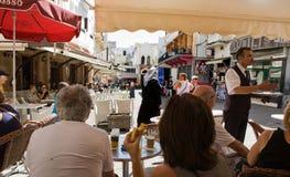 A waiter serves milk at Petit Souk Place, Tangier, Morocco Stock Photography