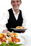 Waiter serves pasta Stock Images