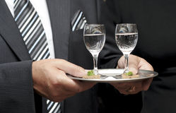 Waiter serving. Glasses of drink Royalty Free Stock Photos