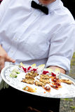 Waiter serving appetizers Royalty Free Stock Photos