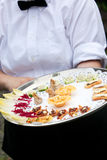 A waiter serving appetizers at a wedding royalty free stock photography