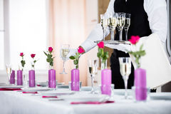 Waiter Serving Banquet Table royalty free stock image