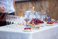 Waiter serving banquet table Stock Photo