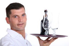 Waiter serving a  beer Stock Photography