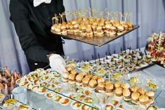 Waiter serving catering table Royalty Free Stock Image