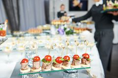 Waiter serving catering table Royalty Free Stock Images