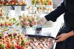 Waiter serving catering table Stock Images
